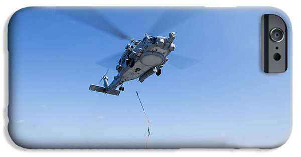 At Arrivals iPhone Cases - An Sh-60r Seahawk Delivers Supplies iPhone Case by Stocktrek Images