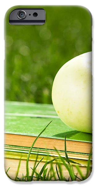 Apple on pile of books on grass iPhone Case by Michal Bednarek