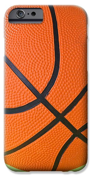 basketball ball over a green background iPhone Case by G J