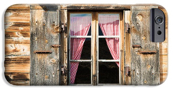 Brown Swiss iPhone Cases - Beautiful window wooden facade of a Chalet in Switzerland iPhone Case by Matthias Hauser