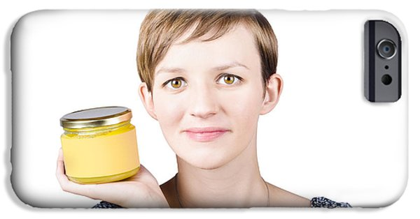 Youthful iPhone Cases - Beautiful young woman displaying jar of ghee iPhone Case by Ryan Jorgensen