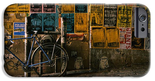 Alley iPhone Cases - Bicycle Leaning Against A Wall iPhone Case by Panoramic Images