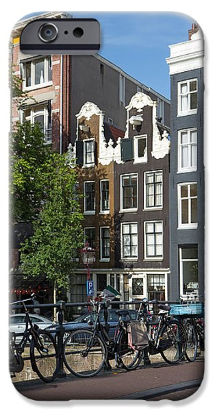 Canal Street Line iPhone Cases - Bicycles on the bridge in Amsterdam iPhone Case by Jaroslav Frank