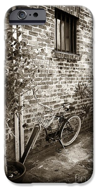 Bike in Pirates Alley iPhone Case by John Rizzuto