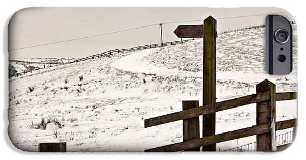 Harsh Conditions iPhone Cases - Blank wooden signpost on snow covered moorland iPhone Case by Ken Biggs