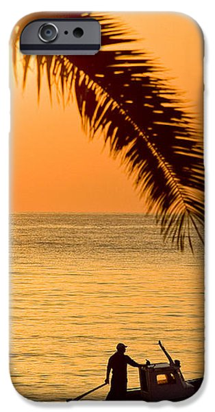 Boat at sea Sunset golden color with palm iPhone Case by Raimond Klavins