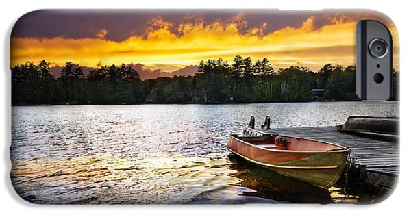 Rural iPhone Cases - Boat on lake at sunset iPhone Case by Elena Elisseeva