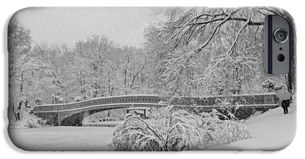 Wintertime iPhone Cases - Bow Bridge In Central Park During Snowstorm BW iPhone Case by Susan Candelario