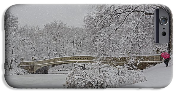Wintertime iPhone Cases - Bow Bridge In Central Park During Snowstorm iPhone Case by Susan Candelario