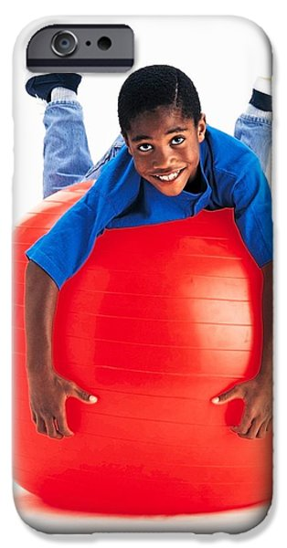 Boy Balancing On Exercise Ball iPhone Case by Ron Nickel