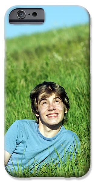 Handsome People iPhone Cases - Boy lying on the fresh green grass iPhone Case by Michal Bednarek