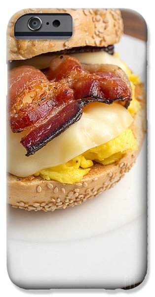 Business iPhone Cases - Breakfast sandwich of bacon egg cheese on a bagel iPhone Case by Edward Fielding