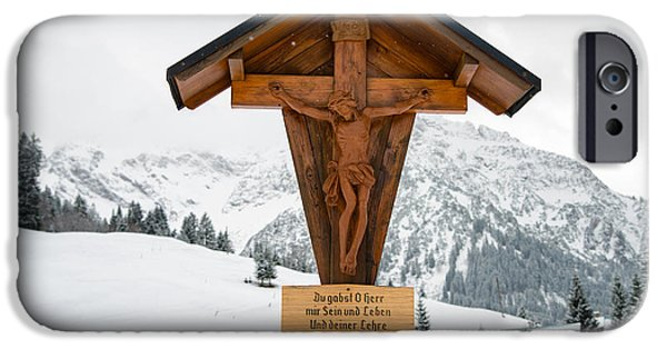 Wayside Cross iPhone Cases - Brown wayside crucifix in the mountains in winter with snow iPhone Case by Matthias Hauser