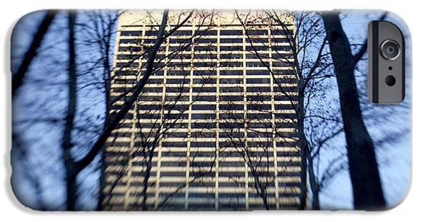Buildings iPhone Cases - Building through trees iPhone Case by Tony Cordoza