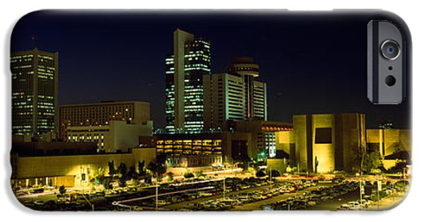 Built Structure iPhone Cases - Buildings In A City Lit Up At Night iPhone Case by Panoramic Images