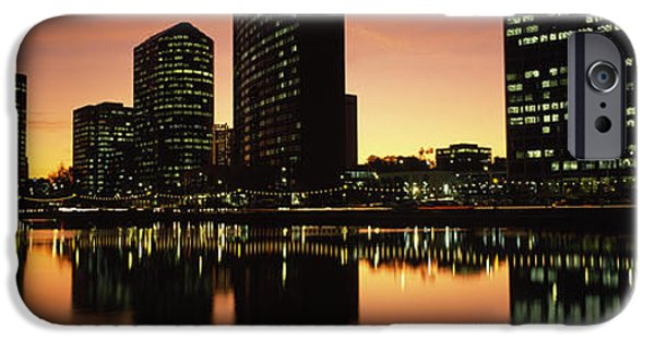Built Structure iPhone Cases - Buildings Lit Up At Dusk, Oakland iPhone Case by Panoramic Images