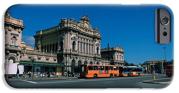 Genoa iPhone Cases - Bus Parked In Front Of A Railroad iPhone Case by Panoramic Images