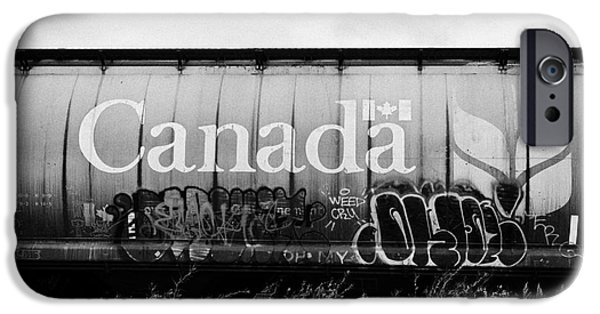 Vandalize Photographs iPhone Cases - Canada freight grain trucks with tag graffiti on canadian pacific railway Saskatchewan Canada iPhone Case by Joe Fox