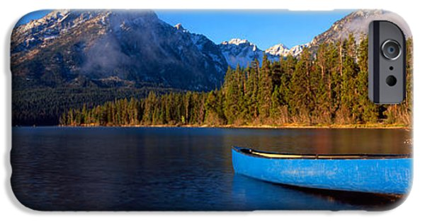 Reflections Of Sky In Water iPhone Cases - Canoe In Lake In Front Of Mountains iPhone Case by Panoramic Images