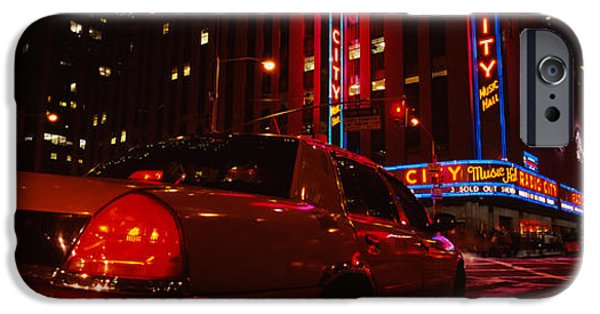 Commercial Photography iPhone Cases - Car On A Road, Radio City Music Hall iPhone Case by Panoramic Images