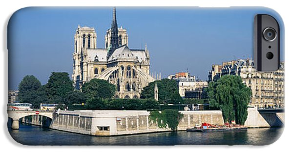 Notre Dame Cathedral iPhone Cases - Cathedral Along A River, Notre Dame iPhone Case by Panoramic Images