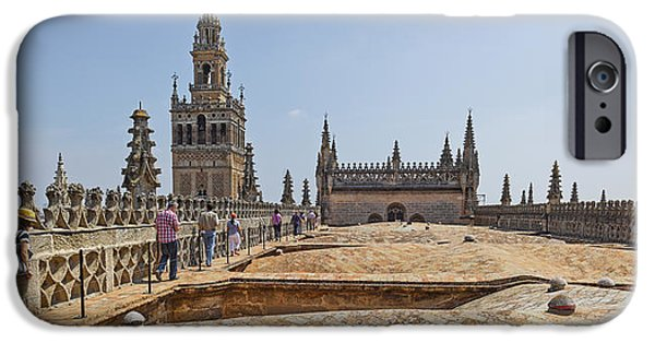 Province iPhone Cases - Cathedral In A City, Seville Cathedral iPhone Case by Panoramic Images