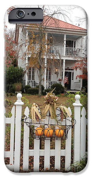 Photographs With Red. iPhone Cases - Charleston Historical Victorian Mansion - Charleston Autumn Fall Trees and White Picket Fence iPhone Case by Kathy Fornal