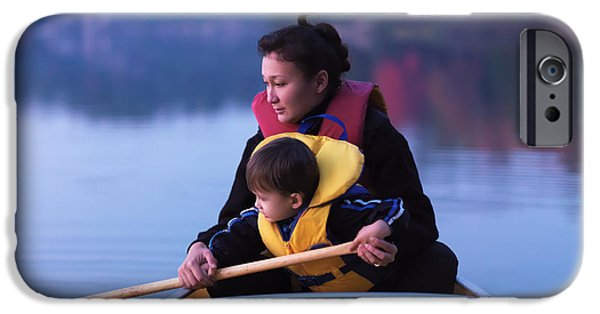 Canoe iPhone Cases - Child learning to paddle canoe iPhone Case by Oleksiy Maksymenko
