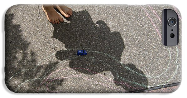 Asphalt iPhone Cases - Childhood - shadow of playing boy iPhone Case by Matthias Hauser