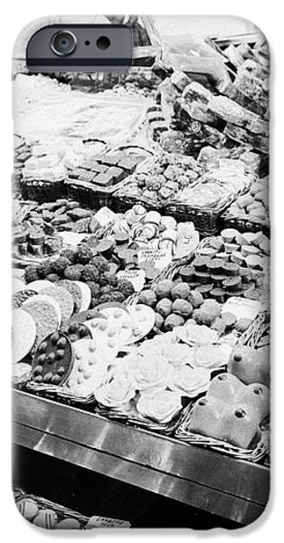 chocolates on display inside the la boqueria market in Barcelona Catalonia Spain iPhone Case by Joe Fox