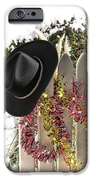 Porch iPhone Cases - Christmas Cowboy Hat on a Fence iPhone Case by Olivier Le Queinec