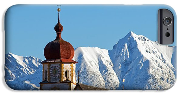 Snowy Day iPhone Cases - Church in alipine scenery iPhone Case by Michal Bednarek