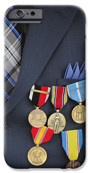 Nation iPhone Cases - Close-up Of Medals And Awards iPhone Case by Stocktrek Images