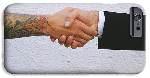 Cooperation iPhone Cases - Close-up Of Two Men Shaking Hands iPhone Case by Panoramic Images