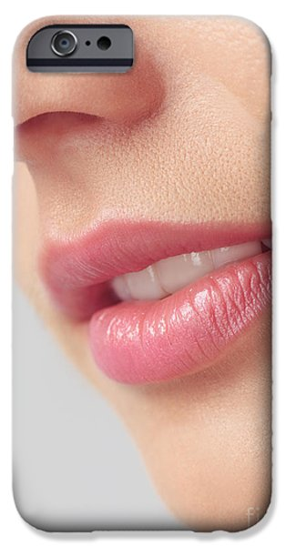 Chin Up Photographs iPhone Cases - Closeup of woman mouth with pink lips iPhone Case by Oleksiy Maksymenko