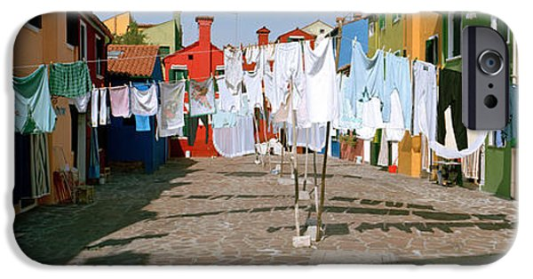 Built Structure iPhone Cases - Clothesline In A Street, Burano iPhone Case by Panoramic Images