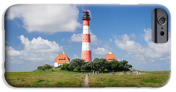 Horizon Over Land iPhone Cases - Clouds Over A Lighthouse iPhone Case by Panoramic Images