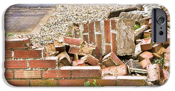 Vandalism iPhone Cases - Collapsed brick wall iPhone Case by Tom Gowanlock
