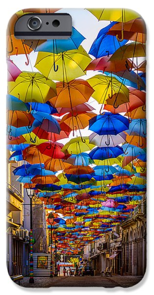 Balcony iPhone Cases - Colorful Floating Umbrellas iPhone Case by Marco Oliveira