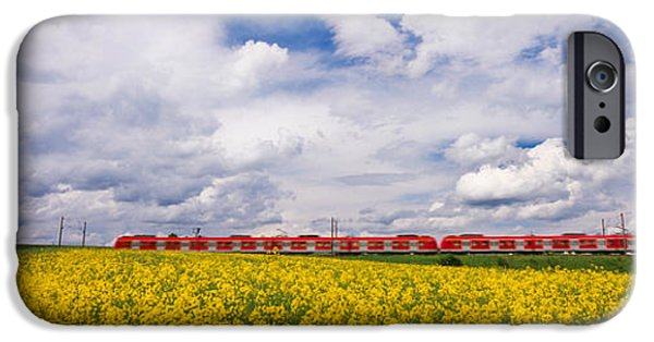 Land Vehicle iPhone Cases - Commuter Train Passing Through Oilseed iPhone Case by Panoramic Images