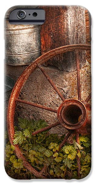 Country - Some dented pails and an old wheel  iPhone Case by Mike Savad