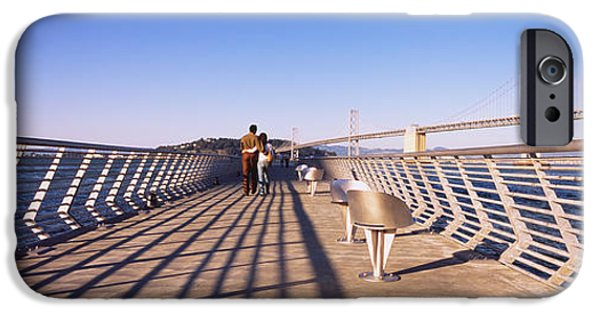Rear View iPhone Cases - Couple Walking On A Pier, Bay Bridge iPhone Case by Panoramic Images