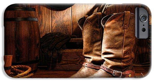 Oil Lamp Photographs iPhone Cases - Cowboy Boots in a Ranch Barn iPhone Case by Olivier Le Queinec
