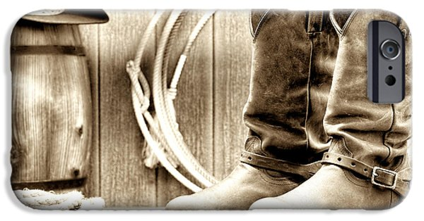Vintage Barns iPhone Cases - Cowboy Boots Outside Saloon iPhone Case by Olivier Le Queinec