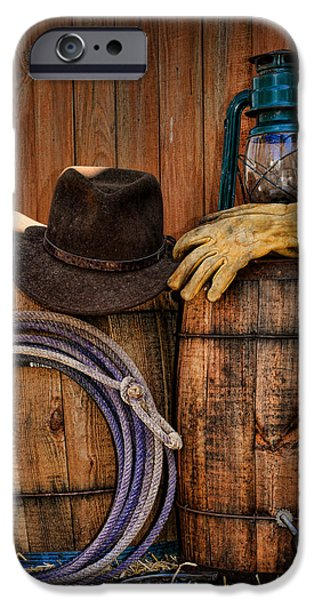 Cowboy Hat and Bronco Riding Gloves iPhone Case by Paul Ward