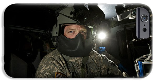 Night Angel iPhone Cases - Crew Chief In A Uh-60 Black Hawk iPhone Case by Terry Moore