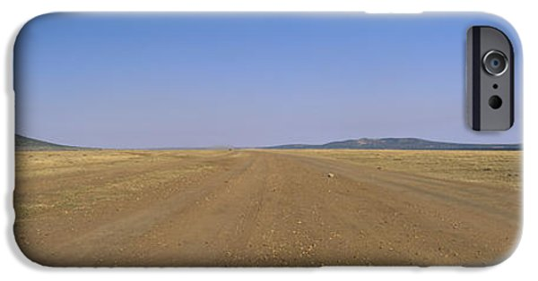 Rift iPhone Cases - Dirt Road Passing Through A Landscape iPhone Case by Panoramic Images
