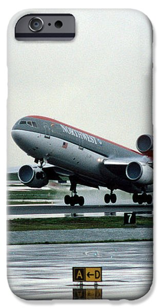 Douglas DC-10-40 Taking Off in the Rain iPhone Case by Wernher Krutein