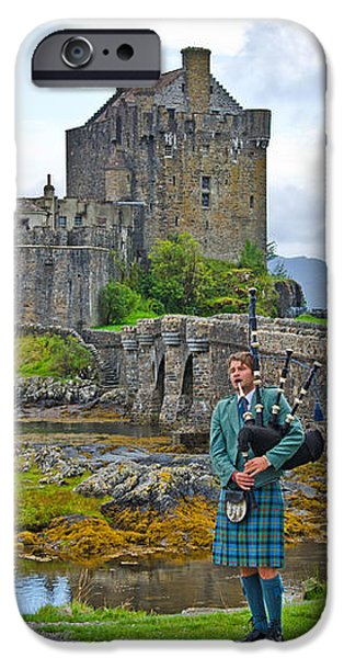 Eilean Donan Castle and the Lone Piper iPhone Case by Chris Thaxter