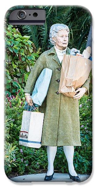 Statue Portrait Photographs iPhone Cases - Elderly Shopper Statue Key West iPhone Case by Ian Monk